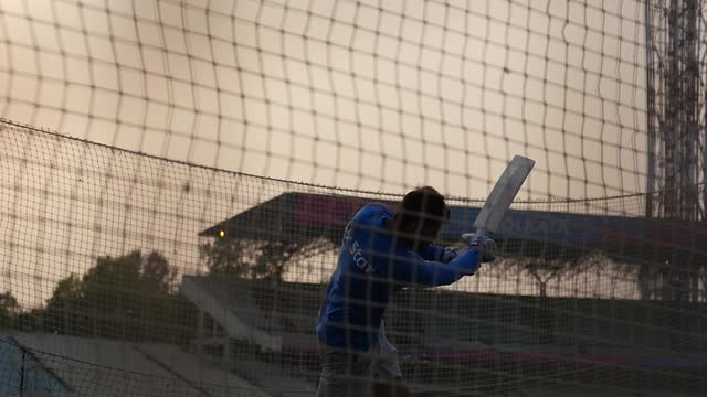 Virat Kohli warms up for India v Pakistan