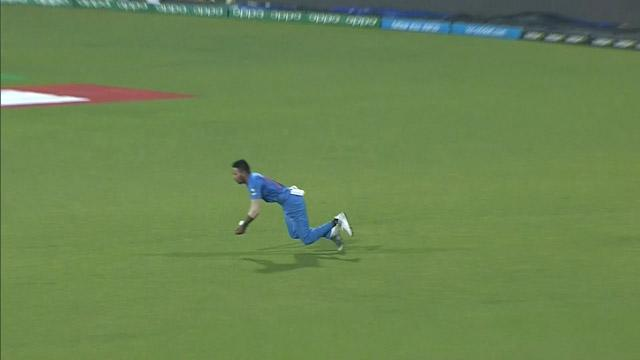 Hardik Pandya clings on to a stunning catch for India!