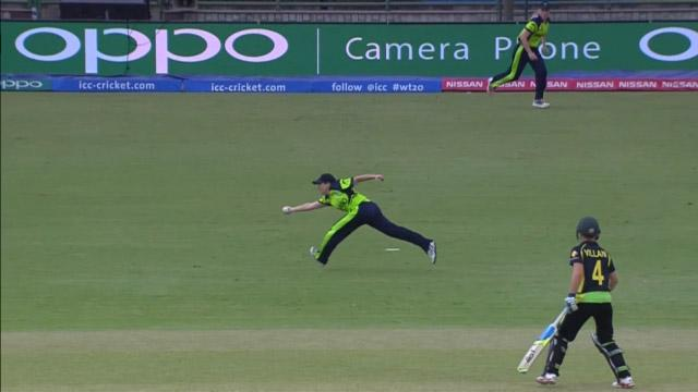 Isobel Joyce clings on to a brilliant diving catch