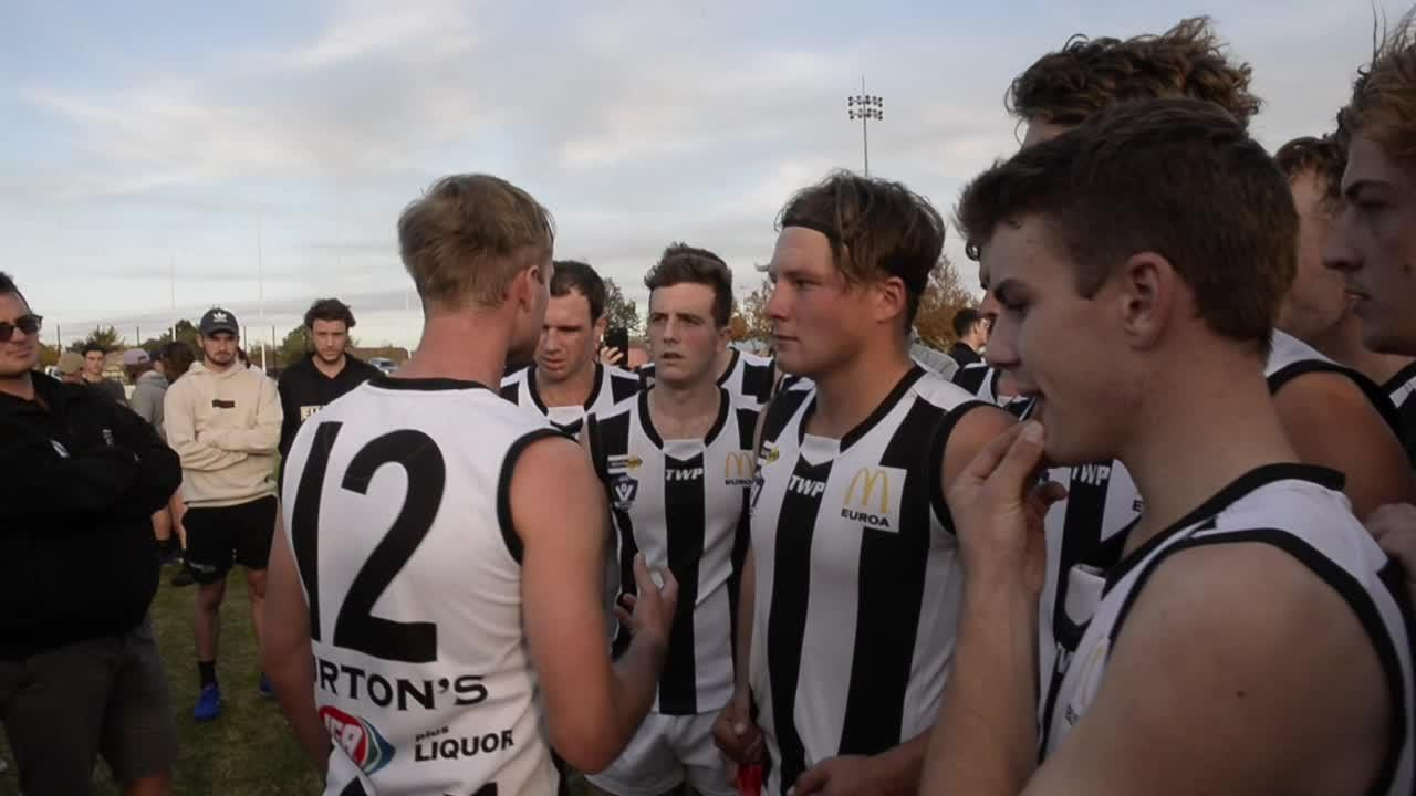 Euroa coach JD Hayes address his players at quarter time